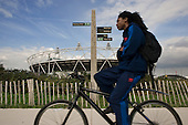 Cycle path and the London 2012 Olympic Stadium construction site.