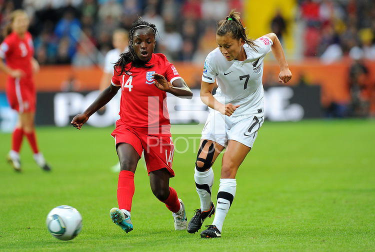 Ali Riley (r) of Team New Zealand and Eniola Aluko of team England during the FIFA Women's World Cup at the FIFA Stadium in Dresden, Germany on July 1st, 2011.