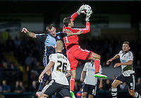 Goalkeeper Marcus Bettinelli of Fulham beats Garry Thompson of Wycombe Wanderers to the ball during an attack on goal during the Capital One Cup match between Wycombe Wanderers and Fulham at Adams Park, High Wycombe, England on 11 August 2015. Photo by Andy Rowland.