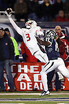 Fresno State's Josh Harper (3) reaches for a catch against Nevada's Evan Favors (19) during the second half of an NCAA college football game in Reno, Nev., on Saturday, Nov. 22, 2014. (AP Photo/Cathleen Allison)