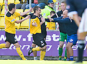 KEAGHAN JACOBS CELEBRATES WITH BOSS GARY BOLLAN AFTER HE SCORES LIVINGSTON'S FOURTH