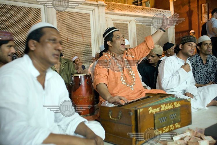 Qawwali singers at the Sufi shrine of Amir Khusrow. Qawwall's are Sufi devotional songs that are sung in praise of God.