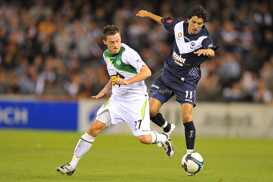 MELBOURNE, AUSTRALIA - FEBRUARY 5, 2010: Marvin Angulo from Melbourne Victory challenges Terry Cooke from North Queensland Fury in round 26 of the A-league match between Melbourne Victory and North Queensland Fury at Etihad Stadium on February 5, 2010 in Melbourne, Australia. Photo Sydney Low www.syd-low.com