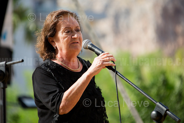 """""""I cannot die without Justice"""" - Augusta Schiera - Mother of Nino Agostino, Police officer killed by Cosa nostra mafia in 1989 along with his pregnant wife Ida Castelluccio.<br /> <br /> Palermo (Sicily - Italy), 19/07/2017. """"Basta depistaggi e omertà di Stato!"""" (""""Stop disinformation & omertá by the State!"""")(1). Public event to commemorate the 25th Anniversary of the assassination of the anti-mafia Magistrate Paolo Borsellino along with five of his police """"scorta"""" (Escorts from the special branch of the Italian police force who protect Judges): Agostino Catalano, Emanuela Loi (The first Italian female member of the police special branch and the first woman of this branch to be killed on duty), Vincenzo Li Muli, Walter Eddie Cosina and Claudio Traina. The event was held at Via D'Amelio, the road where Borsellino was killed. Family members of mafia victims, amongst others, made speeches about their dramatic experiences, mafia violence and unpunished crimes, State cover-ups, silence ('omertá'), and misinformation. Speakers included, amongst others, Vincenzo Agostino & Augusta Schiera, Salvatore & Cristina Catalano, Graziella Accetta, Massimo Sole, Paola Caccia, Luciano Traina, Angela Manca, Stefano Mormile, Ferdinando Imposimato, Judge Nino Di Matteo. The event ended with the screening of the RAI docu-fiction, 'Adesso Tocca A Me' ('Now it's My Turn' - Watch it here: http://bit.ly/2w3WJUX ).<br /> <br /> For more info & a video of the event please click here: http://bit.ly/2eQfNT3 & http://bit.ly/2eQbmrj & http://19luglio1992.com & http://bit.ly/2he8hCj<br /> <br /> (1) 'Omerta' is the term used in Italy to refer to the code of silence used by mafia organisations, as well as the culture of silence that is entrenched in society at large (especially among victims of mafia crimes, as they fear recriminations), about the existence of organised crime and its activities."""