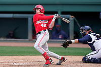 Right fielder Kade Kern (46) of the Ohio State Buckeyes bats in a game against the Illinois Fighting Illini on Friday, March 5, 2021, at Fluor Field at the West End in Greenville, South Carolina. The Illinois catcher is Ryan Hampe. (Tom Priddy/Four Seam Images)