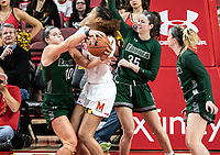 COLLEGE PARK, MD - DECEMBER 8: Stephanie Karcz #10 of Loyola blocks Shakira Austin #1 of Maryland during a game between Loyola University and University of Maryland at Xfinity Center on December 8, 2019 in College Park, Maryland.