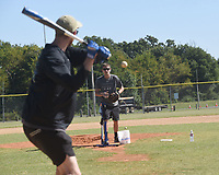 BATTER UP<br />A baseball flies toward batter Tristan Eike of Centerton on Wednesday Sept. 8 2021 as he and Pierson Boelkes of Bella Vista try out a new pictching machine at Phillips Park in Bentonville. The two are baseball enthusiasts and regularly get together to hit some balls, Eike said. Go to nwaonline.com/210909Daily/ to see more photos.<br />(NWA Democrat-Gazette/Flip Putthoff)