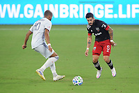 WASHINGTON, DC - AUGUST 25: Junior Moreno #5 of D.C. United battles for the ball with Teal Bunbury #10 of New England Revolution during a game between New England Revolution and D.C. United at Audi Field on August 25, 2020 in Washington, DC.