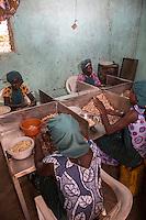 Women Hulling Cashew Nuts.  Group Juboo Cashew Processing Center, Fass Njaga Choi, North Bank Region, The Gambia