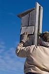 Man closes a wood duck (Aix sponsa) nest cavity (house).  Winter, WI.