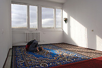 Young Chechen boy, praying at the midday Ramadan pray, in the former workers hotel room transformed into a mosque at the URiC Bielany refugee centre..-For security reason, the face of the adult asylum seeker have been evicted of the photography..-For security reason, the names of the adult asylum seeker have been change. .-Article 9 of the Act of 13 June 2003 on grating protection on the Polish territory (Journal of Laws, No 128, it. 1176) personal data of refugees are an object of particular protection..-Cases where publication of a picture or name of asylum seeker had dramatic consequences for this persons and is family back in Chechnya. .Please have safety of those people in mind. Thank you.