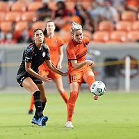 HOUSTON, TX - SEPTEMBER 10: Sophie Schmidt #13 of the Houston Dash passes the ball to a teammate in front of Katie Johnson #33 of the Chicago Red Stars during a game between Chicago Red Stars and Houston Dash at BBVA Stadium on September 10, 2021 in Houston, Texas.