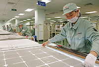 Workers assemble solar power panels at the Suntech factory in Wuxi, China. Suntech is one of the world's top 10 manufacturers of PV cells based on production output..