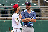West Michigan Whitecaps Gage Workman (27) talks with Drew Swift (7) during a weather delay before a game against the Lansing Lugnuts on August 24, 2021 at Jackson Field in Lansing, Michigan.  (Mike Janes/Four Seam Images)