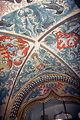 Prague, Czech Republic. Brightly painted vaulted ceiling of the Old Town Hall (Staromestska Radnice) with heraldic design.