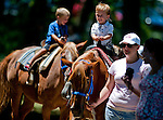 Jakob Pease, of Newark, takes a pony ride on Delaware Handicap Day at Delaware Park in Stanton, Delware on July 16, 2011.