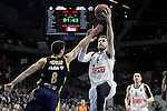 Real Madrid's Andres Nocioni (r) and Alba Berlin's Ismet Akpinar during Euroleague match.March 12,2015. (ALTERPHOTOS/Acero)