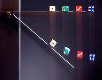 BAR FALLS (ACCELERATES) FASTER THAN DICE<br /> Before & During Fall, Bar Rotates Freely<br /> The dice which appear to be floating above the bar are falling with the acceleration of gravity (9.8m/s²) which is less than the acceleration of the bar near that end. The dice still sitting on the bar are falling at the same rate or faster than the bar.