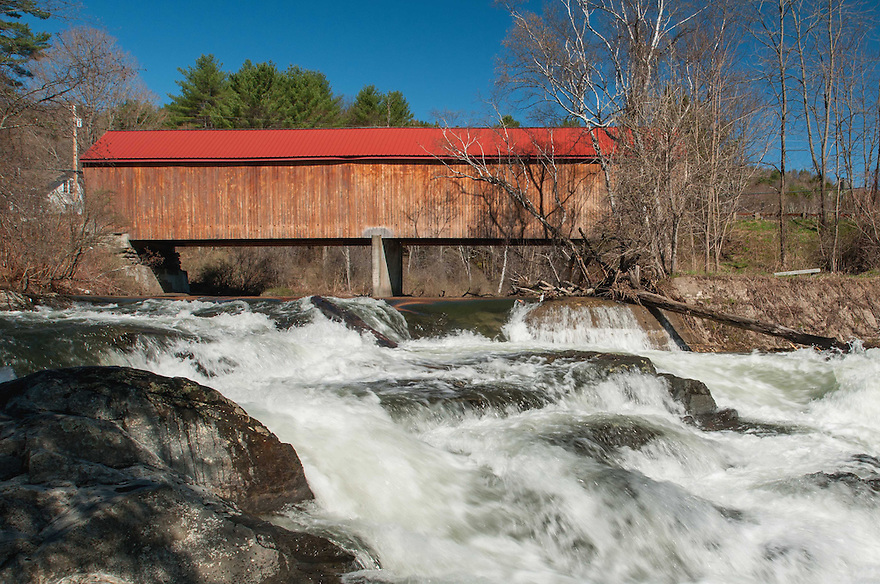 The Thetford Center Covered Bridge spans 127 feet of the East Ompompanoosuc River using the Herman Haupt truss design and has a tumultuous series of cascades just downstream. Recently renovated, it can be photographed from several spots upstream and down.