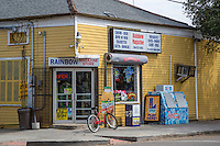 New Orleans, Louisiana.  Corner Grocery Store, Rainbow Magazine, with Rolling Security Shutter over Window, Metal Gates on Front. Uptown District.