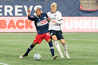 FOXBOROUGH, MA - OCTOBER 19: Teal Bunbury #10 of New England Revolution defends as Jakob Glesnes #5 of Philadelphia Union tackles during a game between Philadelphia Union and New England Revolution at Gillette on October 19, 2020 in Foxborough, Massachusetts.