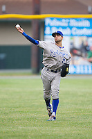 Burlington Royals left fielder Ariel Estades (21) warms up between innings of the game against the Pulaski Mariners at Calfee Park on June 20, 2014 in Pulaski, Virginia.  The Mariners defeated the Royals 6-4. (Brian Westerholt/Four Seam Images)