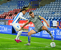 Lincoln City's Harry Toffolo shields the ball from Huddersfield Town's Josh Koroma<br /> <br /> Photographer Andrew Vaughan/CameraSport<br /> <br /> The Carabao Cup First Round - Huddersfield Town v Lincoln City - Tuesday 13th August 2019 - John Smith's Stadium - Huddersfield<br />  <br /> World Copyright © 2019 CameraSport. All rights reserved. 43 Linden Ave. Countesthorpe. Leicester. England. LE8 5PG - Tel: +44 (0) 116 277 4147 - admin@camerasport.com - www.camerasport.com