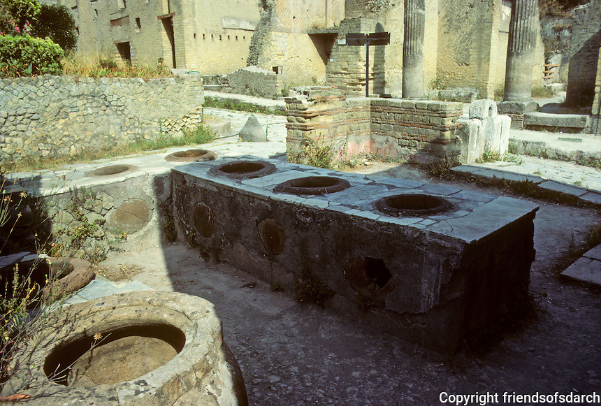 Italy: Herculaneum--Corner shop with vats and tubs for wines and cereals. Photo '83.