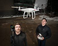 UAA Natural Sciences/Pre Health Junior Tyler Fenton, left, and UAA Finance Senior Trevor (TJ) Wagoner, right, photographed with one of the drones they operate as part of their business 2-Core Films.