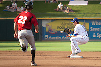 Round Rock Express second baseman Matt Kata #15 turns a double play during the Pacific Coast League baseball game against the Nashville Sounds on August 26th, 2012 at the Dell Diamond in Round Rock, Texas. The Sounds defeated the Express 11-5. (Andrew Woolley/Four Seam Images).