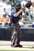 May 24, 2009:  Home plate umpire David Rackley makes a strike call during a game at Frontier Field in Rochester, NY.  Photo by:  Mike Janes/Four Seam Images