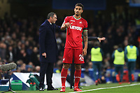 Kyle Naughton of Swansea City in the foreground with Swansea City manager Paul Clement in the background during the Premier League match between Chelsea and Swansea City at Stamford Bridge, London, England, UK. Wednesday 29 November 2017