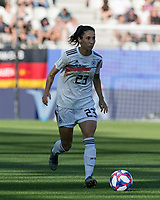 GRENOBLE, FRANCE - JUNE 22: Sara Doorsoun #23 brings the ball forward during a game between Nigeria and Germany at Stade des Alpes on June 22, 2019 in Grenoble, France.