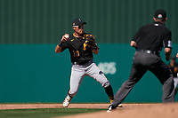 Pittsburgh Pirates shortstop Ji-Hwan Bae (90) throws to first base during a Major League Spring Training game against the Minnesota Twins on March 16, 2021 at Hammond Stadium in Fort Myers, Florida.  (Mike Janes/Four Seam Images)