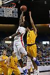 Bishop Gorman's William McClendon shoots past Bishop Manogue defender Joshua Rolling in the 4A NIAA state basketball championship game in Reno, Nev., on Friday, Feb. 23, 2018. Gorman won 62-41. Cathleen Allison/Las Vegas Review-Journal