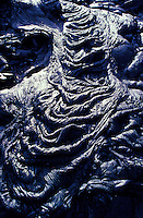 Twisted hardened black lava forms eerie rope coils.