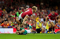 Aled Davies of Wales is tackled by Will Addison of Ireland during the under armour summer series 2019 match between Wales and Ireland at the Principality Stadium, Cardiff, Wales, UK. Saturday 31st August 2019