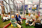 Chelsea Flower Show, London Uk. 1980s A group of visitors are exhausted, resting in on of the display huge greenhouses. 1984.
