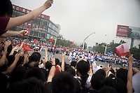 The Olympic torch passes by spectators during the Nanjing, China, leg of the 2008 Olympic Torch Relay.