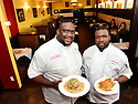 Chefs/Owners Louis E. Brown III and Same Faciane with the Eggplant Napoleon and Smothered Catfish at Southern Charm Bistreaux and Bar.