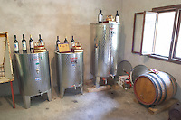 The winery, small scale production, with stainless steel fermentation and storage tanks and one oak barrel. Durovic Jovo Winery, Dupilo village, wine region south of Podgorica. Vukovici Durovic Jovo Winery near Dupilo. Montenegro, Balkan, Europe.