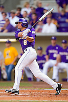 Mikie Mahtook #8 of the LSU Tigers follows through on his swing against the Wake Forest Demon Deacons at Alex Box Stadium on February 20, 2011 in Baton Rouge, Louisiana.  The Tigers defeated the Demon Deacons 9-1.  Photo by Brian Westerholt / Four Seam Images