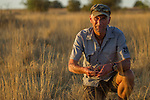 Black-footed Cat (Felis nigripes) veterinarian, Arne Lawrenz, holding tracking collars, Benfontein Nature Reserve, South Africa