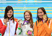 August 02, 2012. L to R: Yi Tang, Aliaksandra Herasimenia, Ranomi Kromowidjojo pose for a photograph with Women's 100m Freestyle Medals at the Aquatics Center on day six of 2012 Olympic Games in London, United Kingdom.