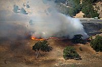 aerial photograph of a spreading grassfire near Lakeport, CA shortly after ignition, Lake County, California.
