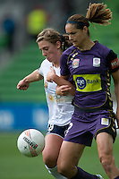 MELBOURNE, AUSTRALIA - DECEMBER 18: Kate GILL of the Glory and Ursula HUGHSON of the Victory compete for the ball during the round 7 W-League match between the Melbourne Victory and the Perth Glory at AAMI Park on December 18, 2010 in Melbourne, Australia. (Photo Sydney Low / asteriskimages.com)