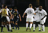 Matt Armstrong #15 and Aaron Maund #2 of the University of Notre Dame congratulate Bright Dike #9 after he scored his first of three goals against the University of Michigan during a men's NCAA match at the new Alumni Stadium on September 1 2009 in South Bend, Indiana. Notre Dame won 5-0.