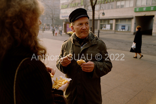 West Berlin, West Germany<br /> November 13, 1989 <br /> <br /> East Germans eat a West German breakfast as they visit the shopping district of West Berlin for the first time. East Germans travel to the West after the East German government lifted travel and emigration restrictions regulations on November 9, 1989.