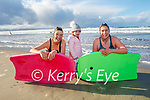 Ready to take to the water in Banna beach on Sunday, l to r: Grace and Becky Pinckheard and Kayla Burke