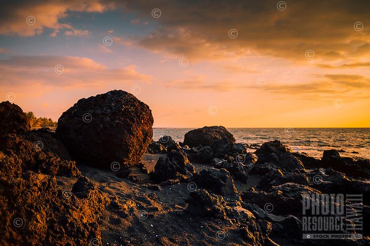 A camping beach lit by the setting sun, Kailua-Kona, western Hawai'i Island.